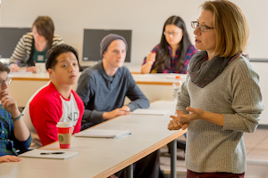 a faculty member speaks to her class